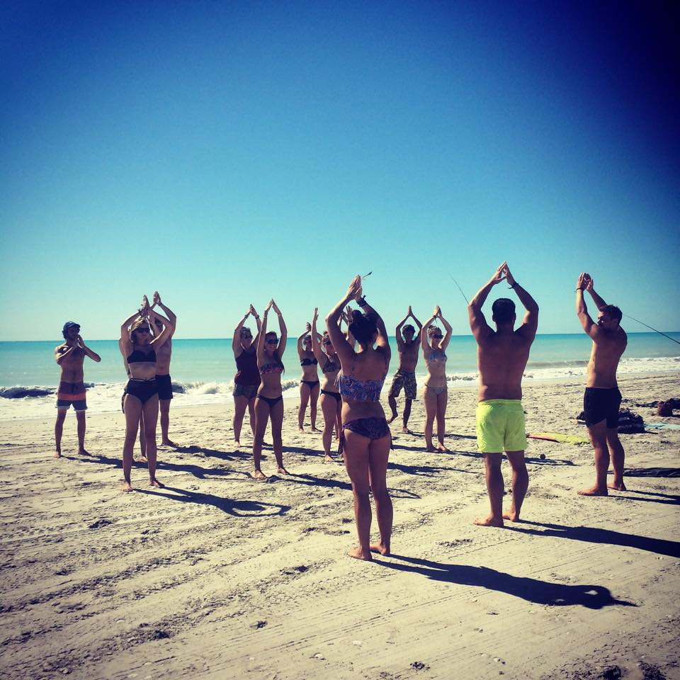 candle-yoga-workout-on-mile-beach-the-magic-bus-australia