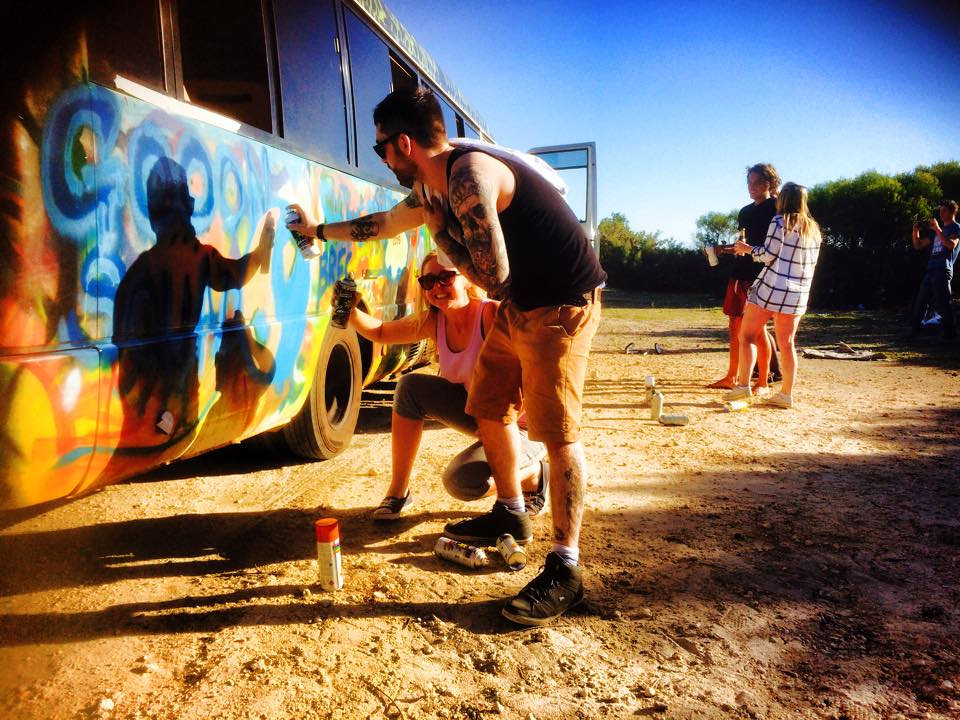 spraying-the-magic-bus-with-backpacker-crew
